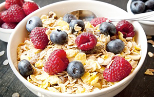 Start the day with a bowl of high fibre cereal like muesli or porridge with some fruit. Fibre is good for you and will keep you feeling fuller for longer.